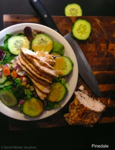 Sliced breast of chicken over fresh greens and simple olive oil and balsamic dressing make up most of my at home meals.