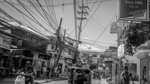 Traffic in every town looks the same. Here the streets of Boracay are as much a maze as its overhead electrical lines.