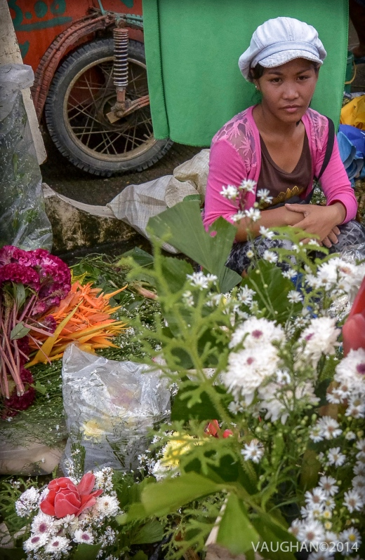 Selling flowers at the local market for those heading to the cemetery on All Soul's Day.