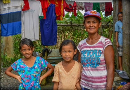 Family is everything in the Philippines. This one gave me the gift of a lovely, spontaneous portrait.