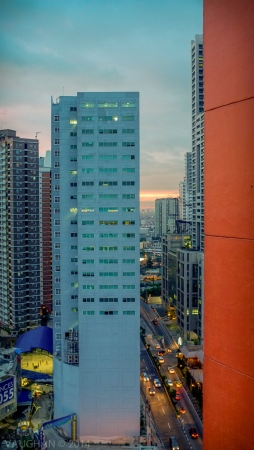 Blue next to orange, buildings. Manila