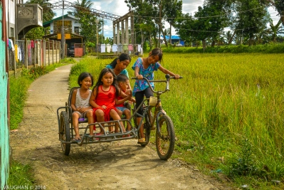 The next best thing to being a kid is simply being with them. I felt my young bones on the back of a bicycle once again, as the children of the rural Philippines have little in the way of toys or games to play with outside of what their minds can conjure. Turns out, that's a big o'l bag of toys.