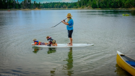 Mick is a man of the woods, the water and the consummate Grandfather. He also plays a handmade flute. If he's not paddling something, he's making music. Sometimes he's doing both as this photo implies. The children are all the richer for his presence no matter what he's teaching them.